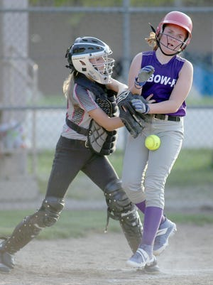 A-Bow-K's Mabry Caton beats the tag by River Rats catcher Leah Noll in the third inning Tuesday night in Babe Ruth 12U softball at Rolling Hills park.