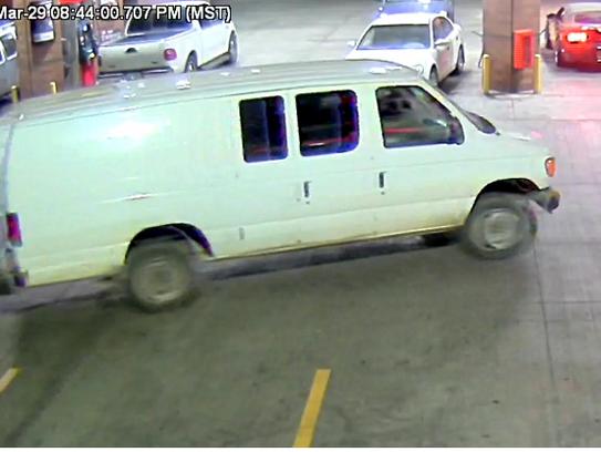 Surveillance video shows a white Ford Econoline van