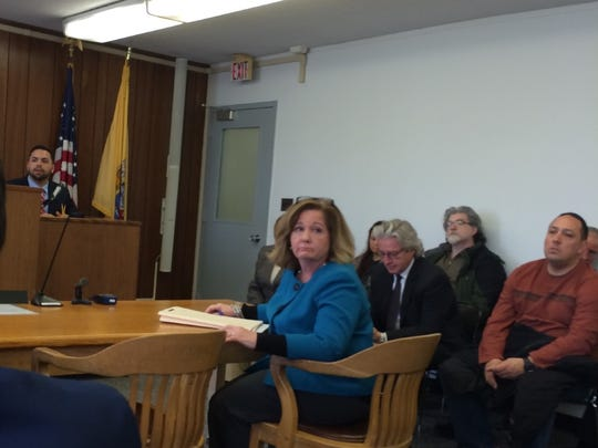 Ramapo Mountain Lakes attorney Eileen Born listens to resident concerns during a case management conference Thursday.