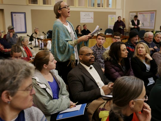 Melissa Hoffman expresses her concerns about the high lead levels found at her children's school, Caroline Elementary School, during a town hall meeting March 3 organized by Assemblywoman Barbara Lifton in Ithaca.