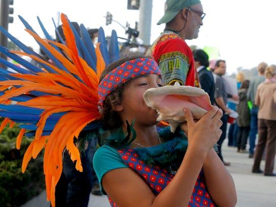 Miriam Corona, 10, participates in an anti-racism protest