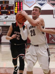 Genoa's Matt Bradfield tries to score Tuesday against Fostoria.