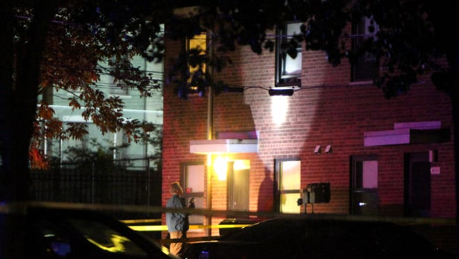 Police investigate a shooting in West End late Wednesday night.