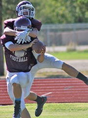 A Tularosa receiver makes a catch under heavy pressure during one-on-one's.