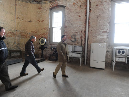 Paul Smith, Jerry Miller and Steve Cummins tour the future home of the Industrial Manufacturing Museum that will be housed inside the OSR.