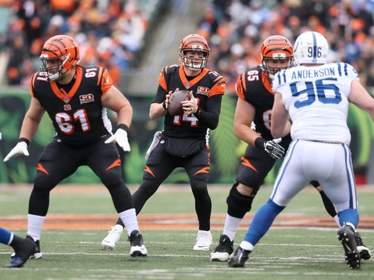 Cincinnati Bengals quarterback Andy Dalton (14) takes the snap in the first quarter during the Week 8 NFL game between the Indianapolis Colts and Cincinnati Bengals, Sunday, Oct. 29, 2017, at Paul Brown Stadium in Cincinnati.