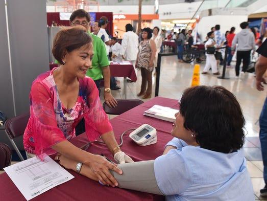Guam Diabetes Association volunteer Miriam Piana gives