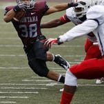 Montana running back John Nguyen carries the football against Oklahoma Panhandle State defense in 2013.