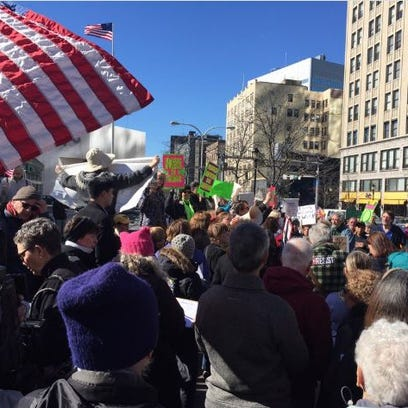 A speaker calls for passage of Westchester immigrant
