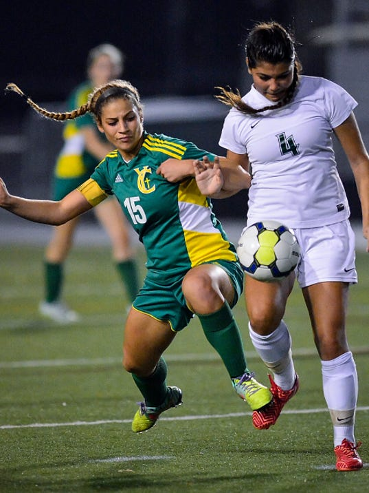 York Catholic's Elizabeth Johnson collides with Sage Magruder of Trinity during the District 3-A girls' soccer championship at Hersheypark Stadium on Thursday. York Catholic lost the game, 3-0.