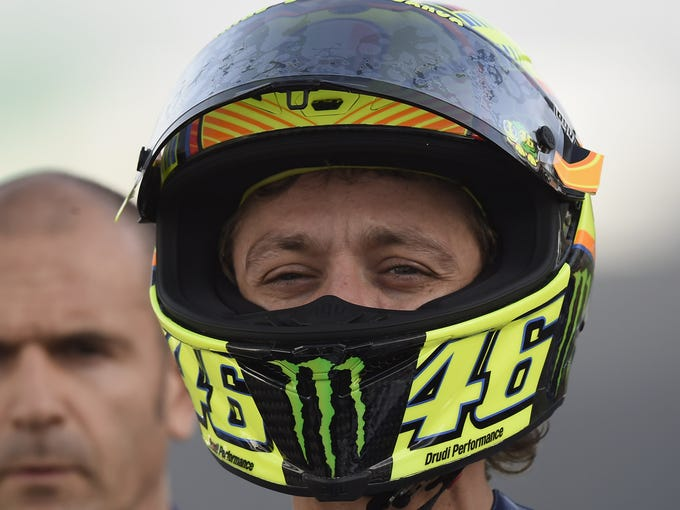 DOHA, QATAR - MARCH 19:  Valentino Rossi of Italy and Yamaha Factory Racing poses during the Movistar Yamaha MotoGP YZR-M1 Unveiling  during the MotoGp of Qatar - Press Conference at Losail Circuit on March 19, 2014 in Doha, Qatar.  (Photo by Mirco Lazzari gp/Getty Images)