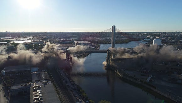 Shown  is an aerial sequence of the implosion of more
