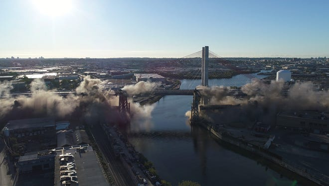 Shown  is an aerial sequence of the implosion of more than 900 detonator charges bringing down the the spans of the former Kosciuszko Bridge to the ground through an energetic felling process on Sunday, October 1, 2017.