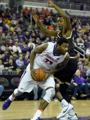 Willie Wiley III of the University of Evansville drives under the basket while being guarded by Darral Willis Jr., of Wichita State during the first half of the game at the Ford Center in Evansville, Ind., Tuesday.