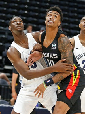 Grizzlies forward Jaren Jackson Jr., left, and Hawks forward John Collins (20) battle for position under the basket during the first half of a Summer League basketball game in July.
