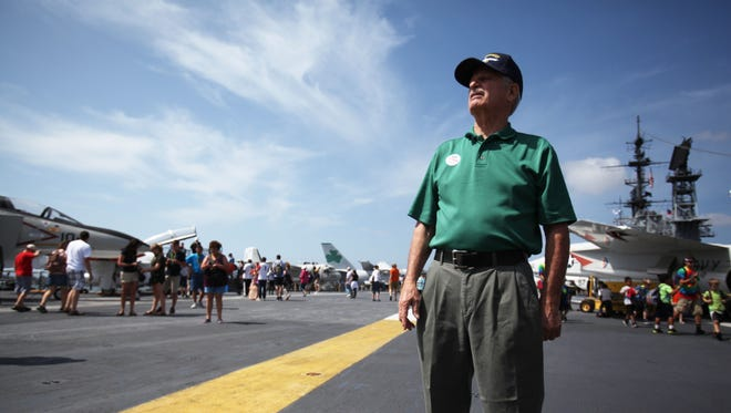 """Vietnam Veteran Bill Hawkins looks over the various aircraft on display on the USS Midway aircraft carrier on April 1, The Desert Hot Springs resident served on the Midway, now in San Diego, during Operation Frequent Wind when thousands of """"at risk"""" Vietnamese were fleeing the country hours before the fall of Saigon."""