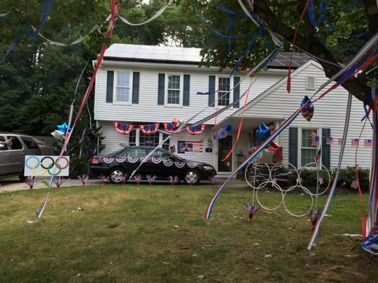 Members of the community in Westampton, N.J., decorated Kelsi Worrell's family home in celebration of her making the U.S. Olympic team.