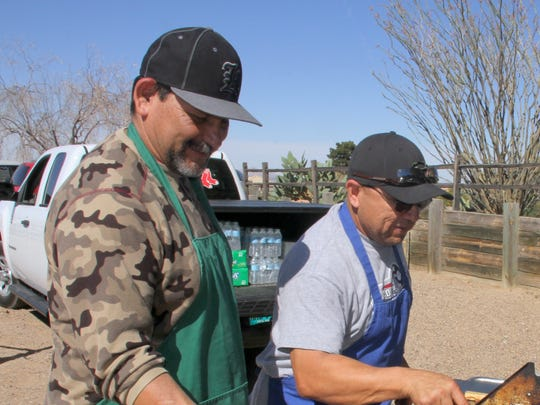 From left, Gilbert Clemente and Johnny Reyes grilled hot dogs for the ninth annual Lenten Youth Walk Saturday at Rockhound State Park.