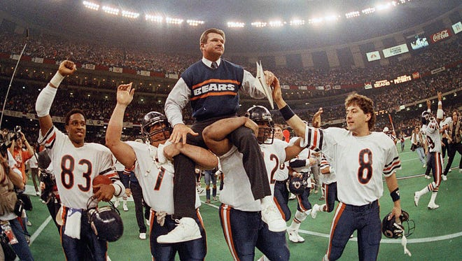 Chicago Bears coach Mike Ditka is carried off the field by Steve McMichael, left, and William Perry after the Bears defeated the New England Patriots 46-10 in NFL football's Super Bowl XX in New Orleans in 1986. The Bears were 15-1 in the regular season.