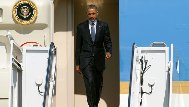 President Obama exiting Air Force One on July 16, 2015.