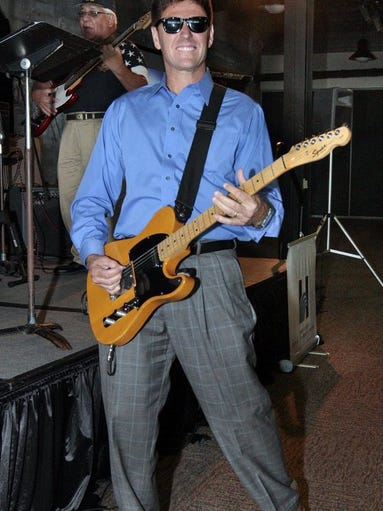 GEORGE TULEY/SPECIAL TO THE CALLER-TIMES Juan M. Garcia, the Hispanic Chamber of Commerce's 2016 Legacy Award recipient, donned a pair of sunglasses during the luncheon honoring him and picked up a guitar to join the Corpus Christi Veterans Funky Band on Wednesday, July 13, 2016, at the Congressman Solomon P. Ortiz International Center in Corpus Christi. Garcia, a Robstown native, is a former assistant secretary of the Navy. He also served as a Navy pilot, as did his father.