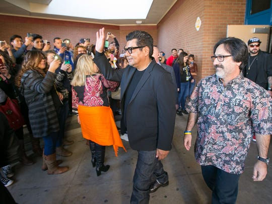"""Actor George Lopez walks with Faridodin """"Fredi"""" Lajvardi, the Carl Hayden Community High School robotics coach whose story Lopez helped bring to the big screen. The movie, """"Spare Parts,"""" was screened at the school in January."""