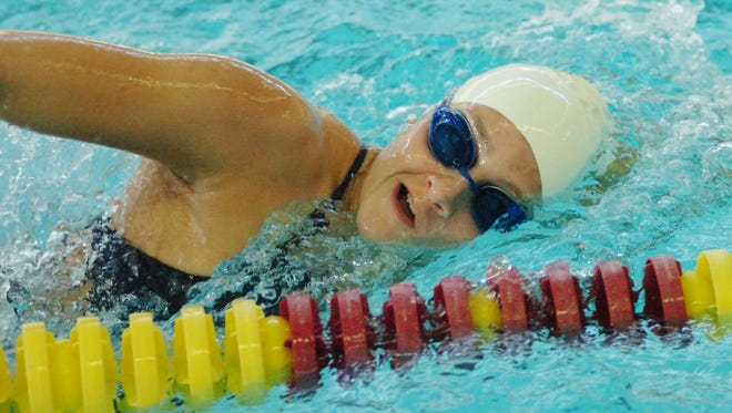 Junior Katie Minnich is a two-time defending state champion in the 100-yard backstroke.