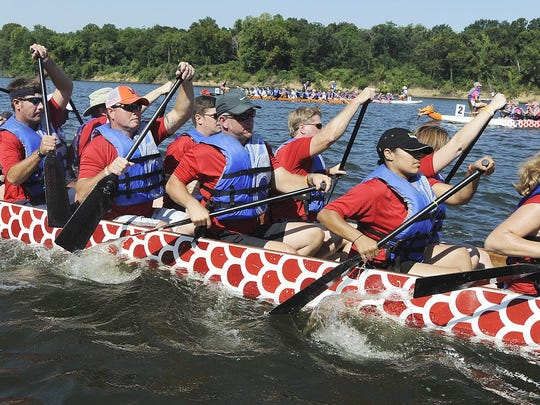 Rowers compete in the Dragon Boat Race and Festival.