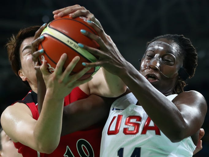 Tina Charles #14 of United States battles for the ball