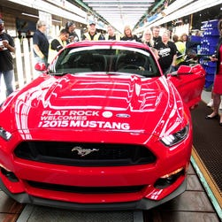 The first production 2015 Ford Mustang sits waiting to be driven off the assembly line at the Ford Flat Rock Assembly Plant August 28, 2014 in Flat Rock, Mich.