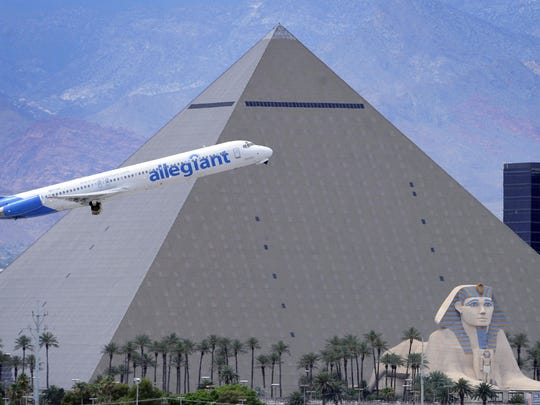 An Allegiant Air jetliner flies by the Luxor Resort and Casino after taking off in 2013 from McCarran International Airport in Las Vegas.