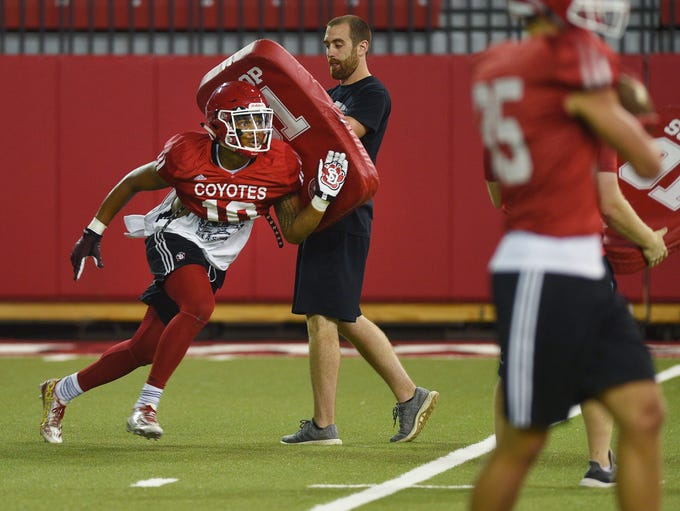 USD's Reggie Crawford runs drills during practice after