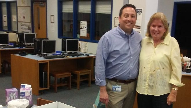 Dr. Christopher Jones, J.D. Parker Elementary School principal, stands with Diane Russo, retiring media assistant, at a retirement party for Russo on Feb. 23. She officially retired Feb. 28.