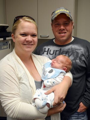Lisa and Tom Compart, of Fort Dodge, and newborn son Henry, are pictured Wednesday, Oct. 29 at the Ponseti Clubfoot Treatment Center inside University of Iowa Hospitals and Clinics.