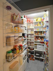 Shelving keeps everything visable in this pantry.