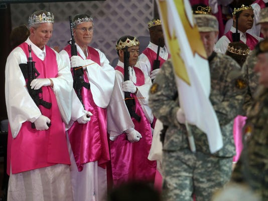 Worshippers clutching AR-15 rifles hold commitment ceremony