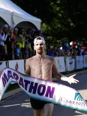 Mason Grundy of the Town of Harrison repeated as the top overall finisher in the Community First Fox Cities Marathon presented by Miron Construction on Sunday in Neenah.