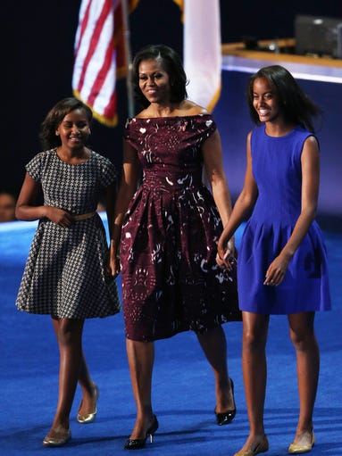 From left, Sasha Obama, First Lady Michelle Obama,