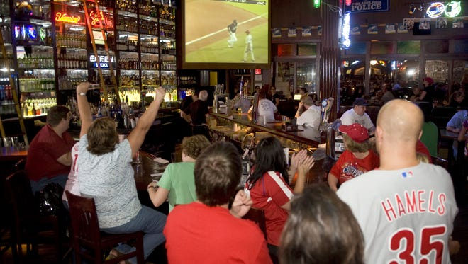 Phillies fans watch the Philadelphia Phillies play the Florida Marlins as they hang out at Chickie's and Pete's in Philadelphia in 2009. The king of Philly sports bars is headed to Rowan University.
