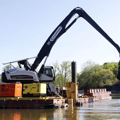 In this May 2015 file photo, crews perform dredging work along the upper Hudson River in Waterford. While the dredging project has been completed, scientists will continue to track contamination levels in the river.