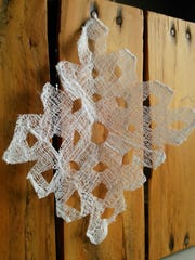 Create your own snowflakes, even if it's not snowing in the valley, with starch and cheesecloth.