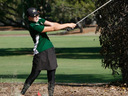 Royal High's Jenna Stuck hits out of a rough spot as she approaches the 10th green at Los Robles Greens Golf Course Monday during the CIF-SS Northern Divison Team Championship Tournament.