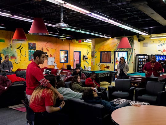 """The Falcon Lounge at Manchester Regional High School in Haledon, NJ offers the students a place to """"hang out"""" in the school.  There are lots of activities, including a pool table."""