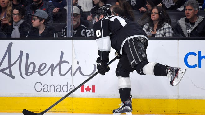 Los Angeles Kings left wing Tanner Pearson limps off the ice after crashing into the boards.