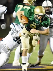 York Catholic quarterback Kyle Dormer tries to break through a tackle against Newport. The Fighting Irish were held to just three rushing yards in their District 3 2-A championship game loss to the Buffaloes on Saturday, Nov. 11, 2017. Dawn J. Sagert - dsagert@yorkdispatch.com