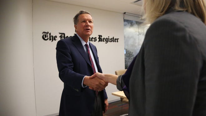 Presidential hopeful and Governor of Ohio, John Kasich meets with the Des Moines Register's editorial board on Thursday, Dec. 17, 2015, in Des Moines.