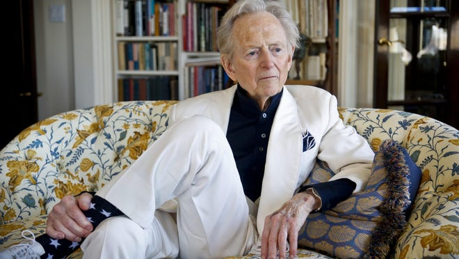 """In this July 26, 2016 file photo, American author and journalist Tom Wolfe, Jr. appears in his living room during an interview about his latest book, """"The Kingdom of Speech,"""" in New York. Wolfe died at a New York City hospital. He was 88. Additional details were not immediately available. (AP Photo/Bebeto Matthews, File)"""