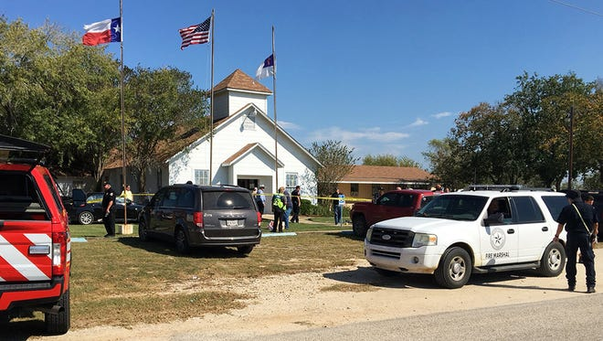 Emergency personnel respond to a shooting at a Baptist church in Sutherland Springs, Texas, on Nov. 5, 2017.