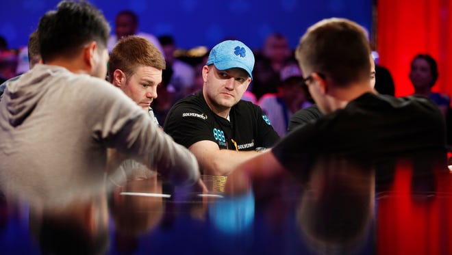 Nic Manion, back right, competes at the final table during the World Series of Poker main event Thursday, July 12, 2018, in Las Vegas. (AP Photo/John Locher)