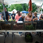 People shop at the Larimer County Farmers Market, one of a number of markets starting soon for the spring, summer and fall growing seasons.